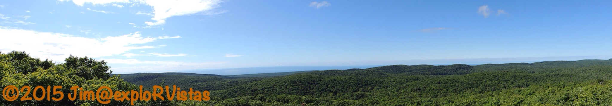 Mt curwood explorvistas what a view if you pull in the horizon on the above panorama you can see wisconsins apostle islands in the distance publicscrutiny Image collections