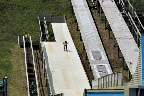 Freestyle skier coming down the ramp