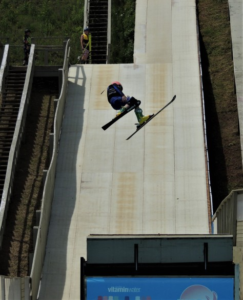 Freestyle skier twisting off the jump