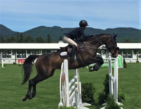 Horse airborne at the Lake Placid Horse Show