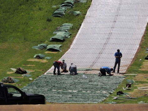 Installing the summer jumping surface on the ski jumps